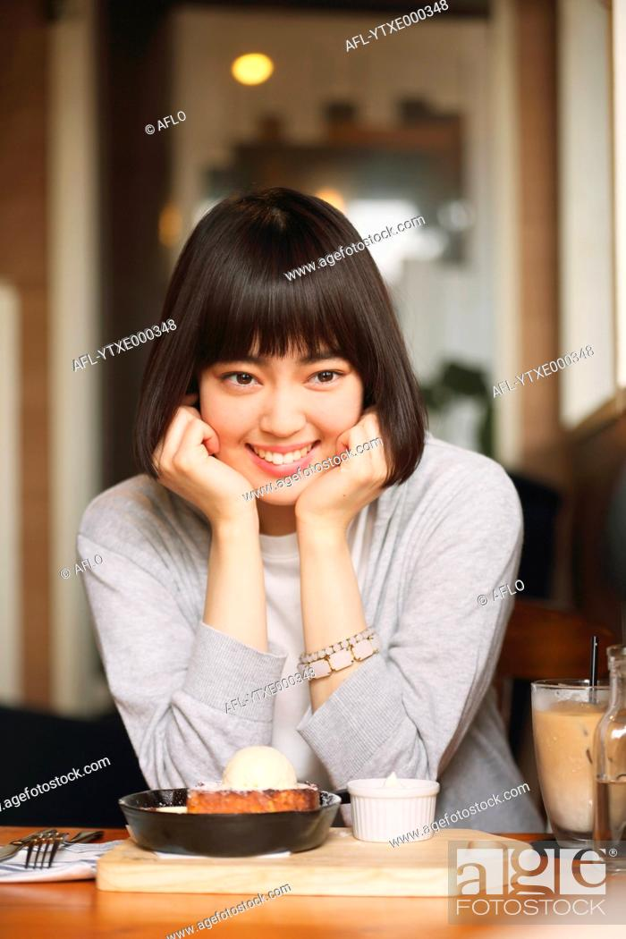 Stock Photo: Young Japanese woman at a cafe downtown Tokyo.