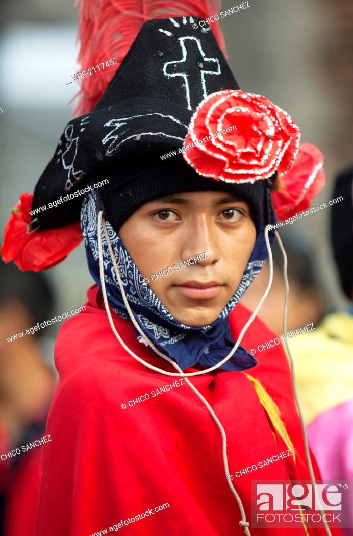 Stock Photo: A young man from Veracruz dresses as Saint James apostle ready to perform the Danza de los Santiagos de Veracruz at the pilgrimage to Our Lady of Guadalupe.