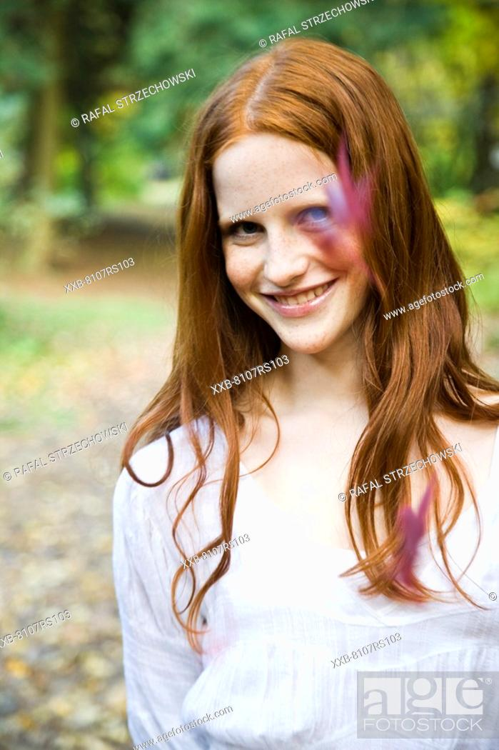 Stock Photo: Autumn portrait of ginger woman.