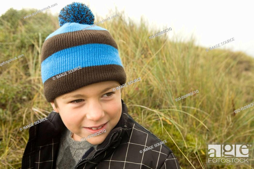 Stock Photo: Boy wearing bobble hat.