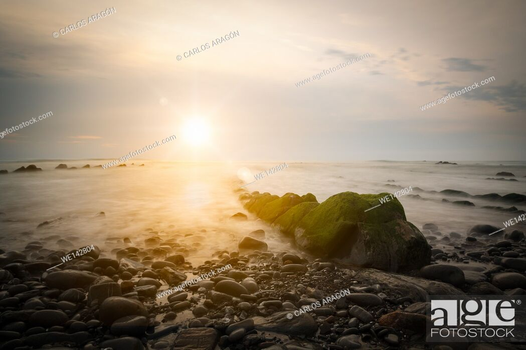 Stock Photo: Road to the sun in barrika beach with rocks and moss. Basque Country, Spain.