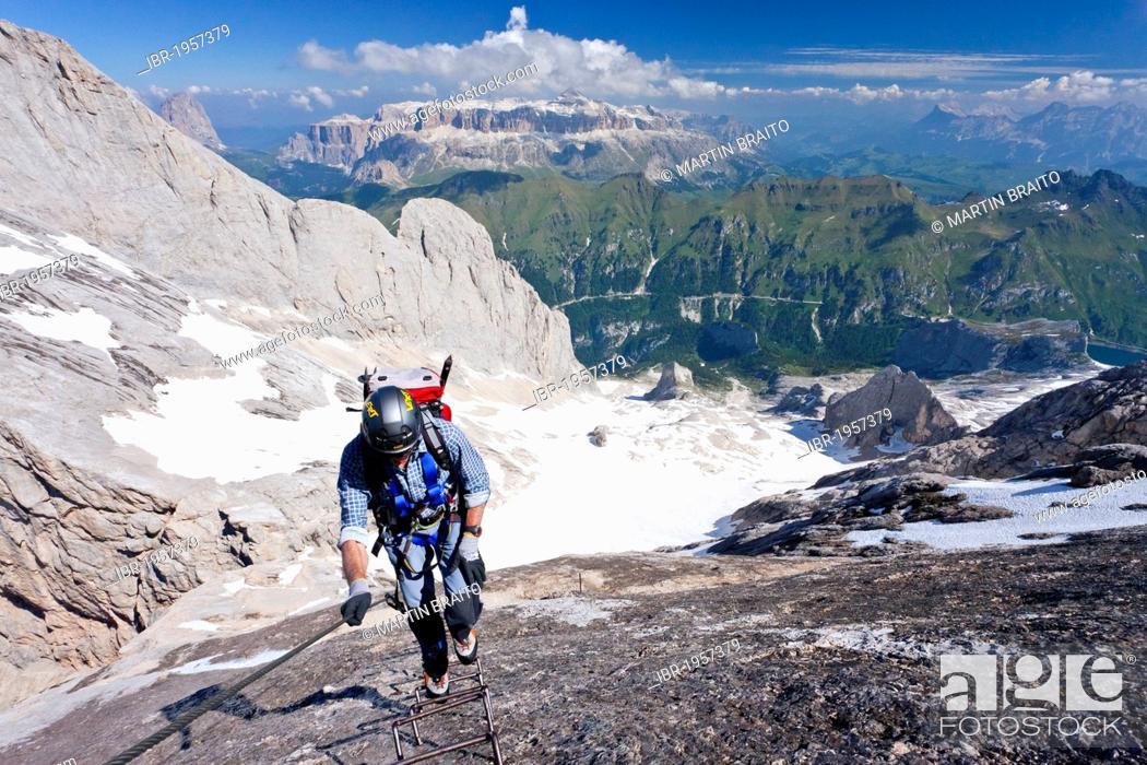 Stock Photo: Mountain climber ascending Marmolada Mountain on the Westgrat climbing route, view towards Sella Mountain, the Heiligkreuzkofelgruppe range.