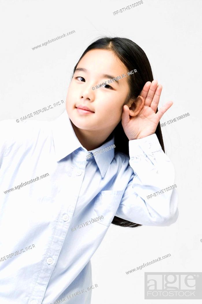 Stock Photo: girl listening carefully.