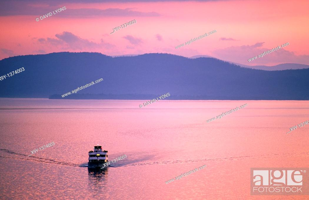 Stock Photo: Lake Champlain, New England, USA  Cruise boat called Ethan Allen looking west from Vermont shore at Burlington to New York State.