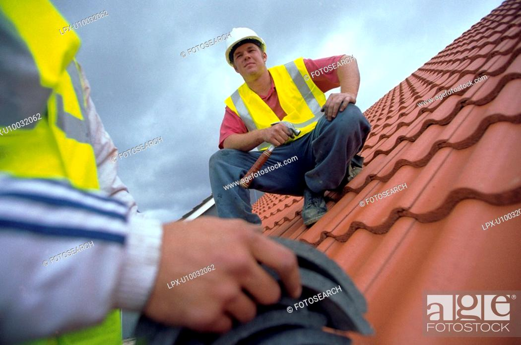 Stock Photo: Roof installation on a new property development.