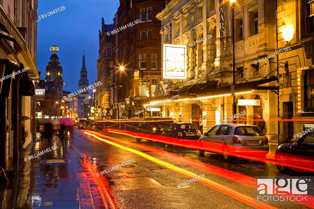 Stock Photo: London, England, St. Martin's Lane at dusk, Noel Coward Theatre, Duke of York's Theatre, Coliseum, Church of St. Martin-in-the-Fields, pubs and restaurants.
