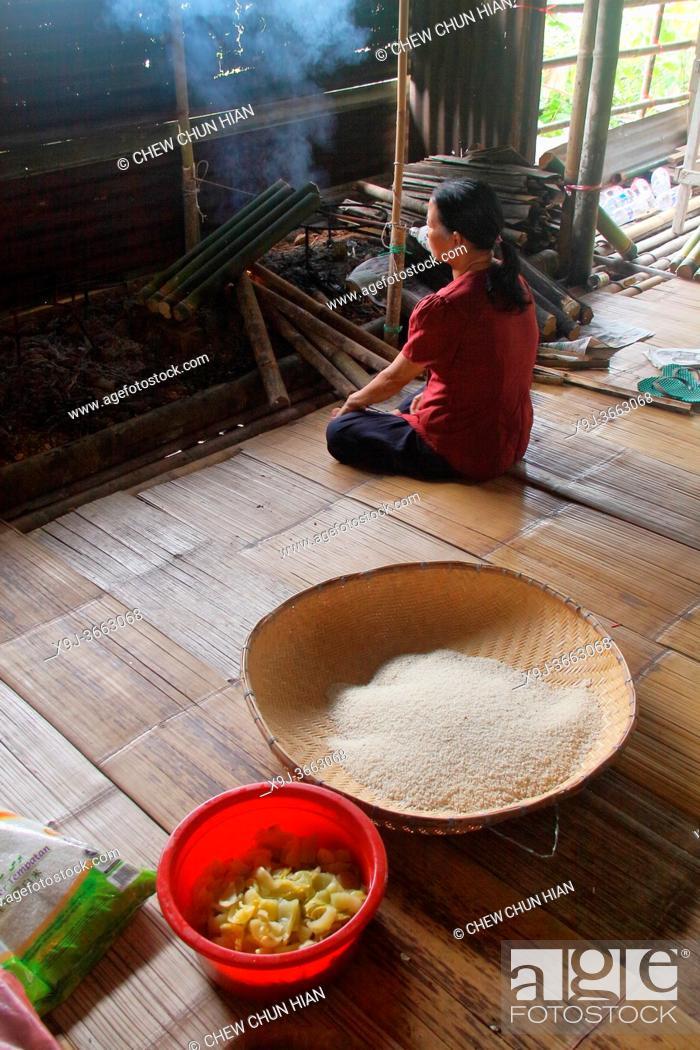 Stock Photo: Bidayu women preparing food, kuching, sarawak, borneo.