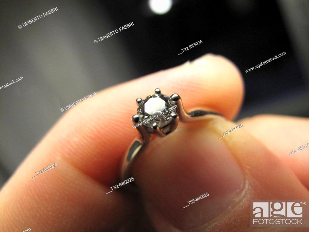 Stock Photo: A diamond ring in the finger.