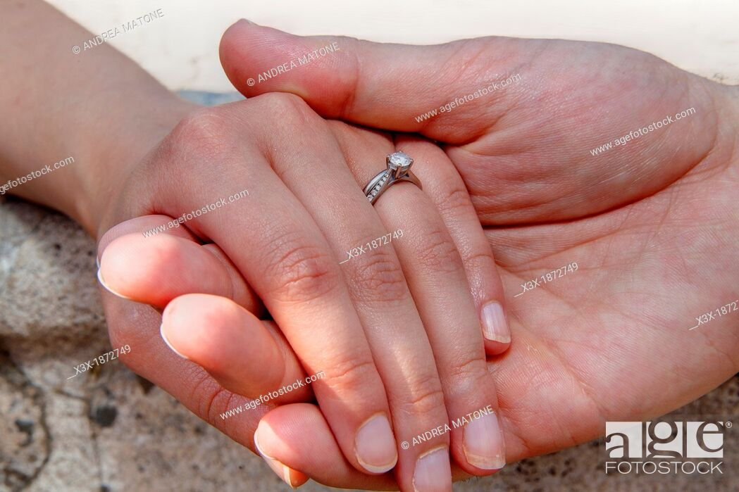Stock Photo: Wedding couple holding hands.
