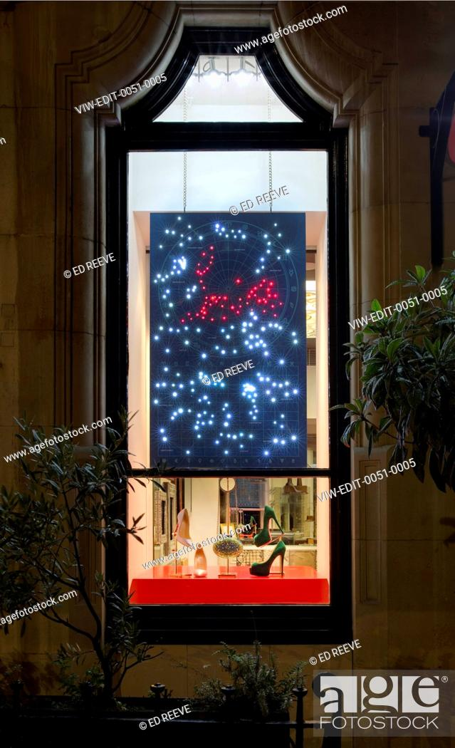 f38b98888b38 Stock Photo - Christian Louboutin Shoe shop. Street View at night of window  display designed by the in-house Visual Merchandising Team