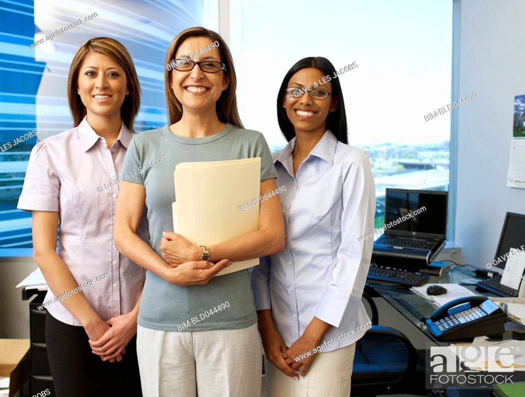 Stock Photo: Multi-ethnic businesswomen in office.