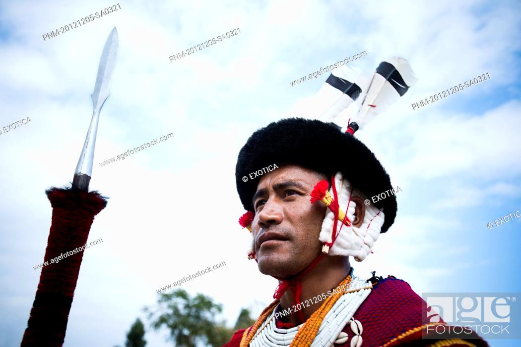 Stock Photo: Naga tribal warrior in traditional outfit with spear, Hornbill Festival, Kohima, Nagaland, India.