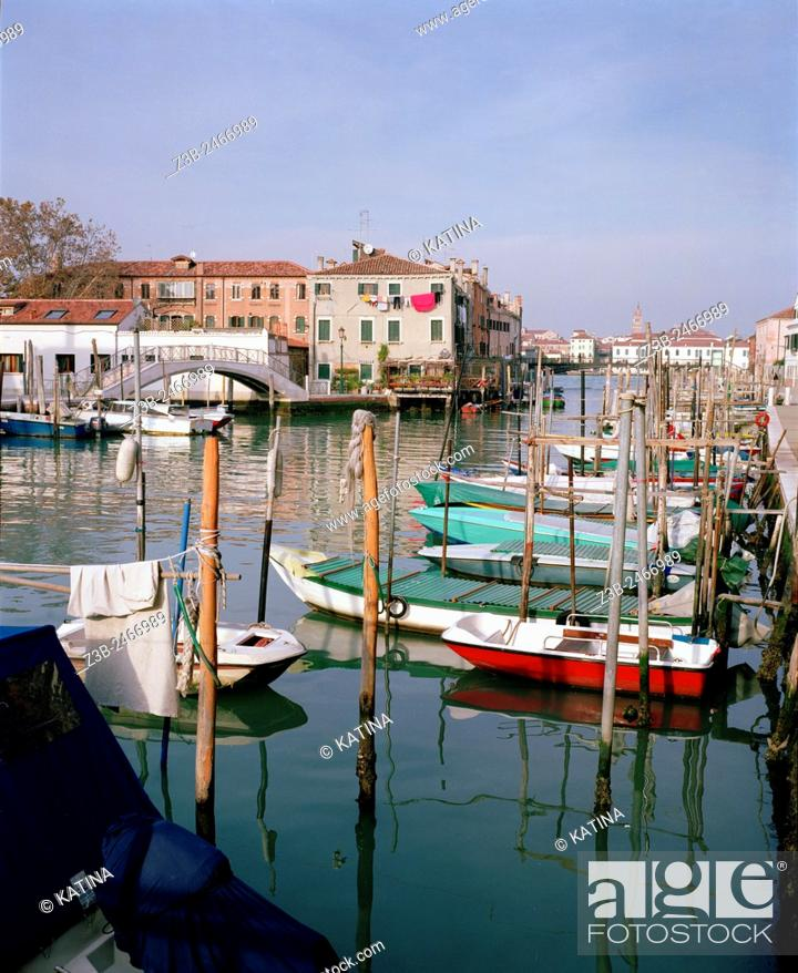 Imagen: Boats docked on peaceful Giudecca Island, a peaceful residential island south of the main islands of Venice, Italy, Europe.