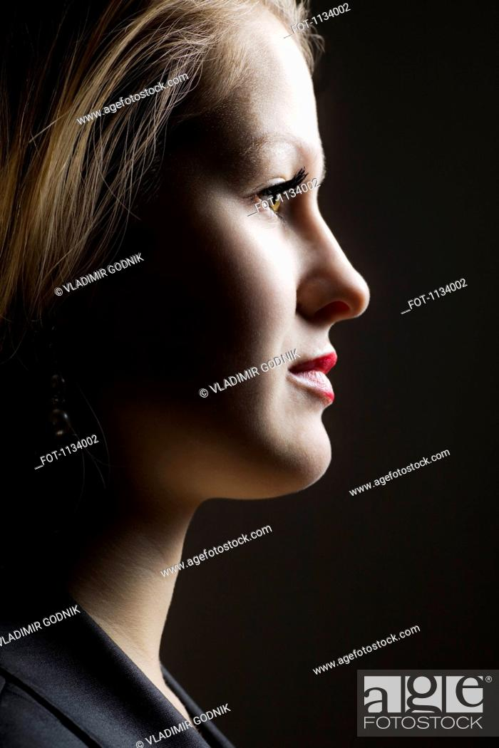 Stock Photo: Shadowed profile of young woman.
