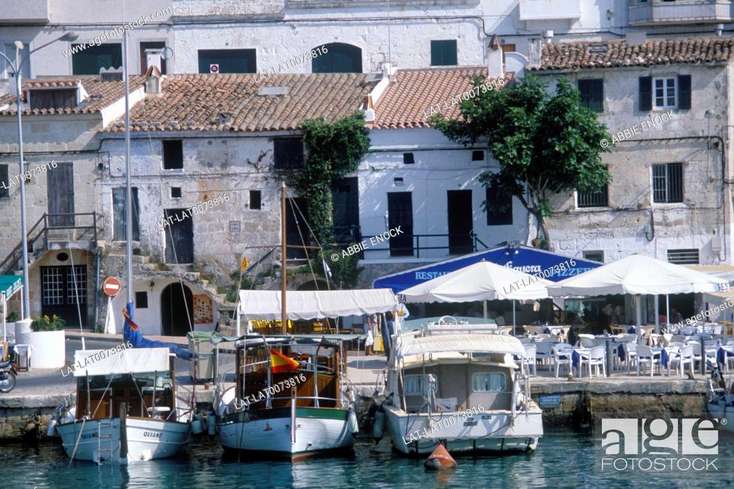 Stock Photo: Balearic island. Cuitadella. Waterfront. Boats moored. Buildings. Cafes. Tables and chairs. People.