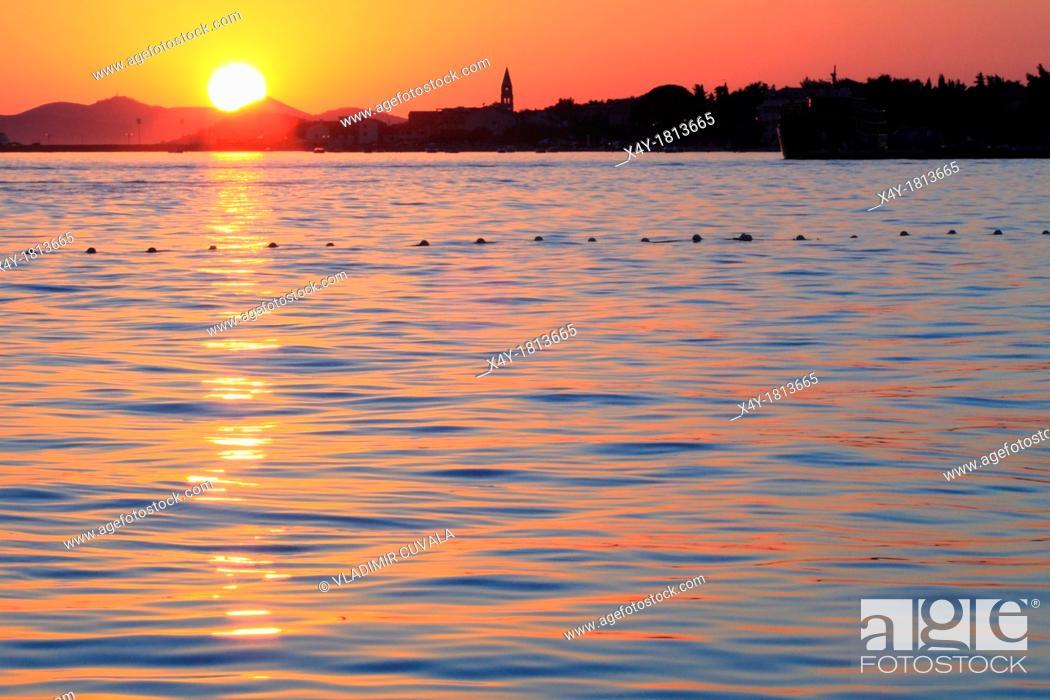 Stock Photo: Sunset on Dalmatian coast, village Turanj, Croatia.