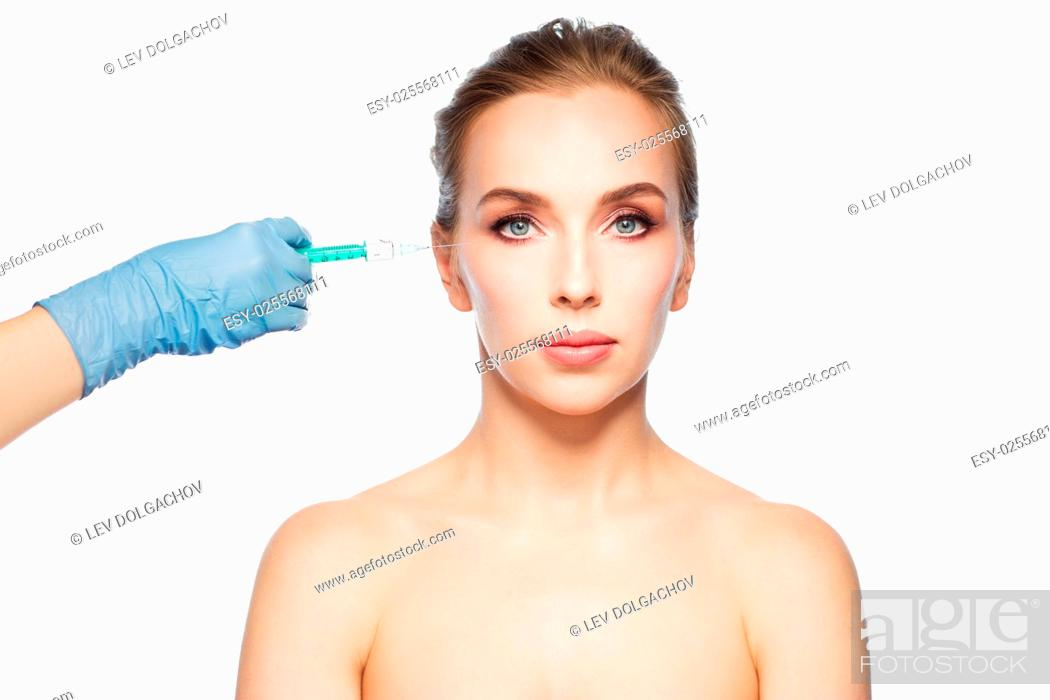 Stock Photo: people, cosmetology, plastic surgery and beauty concept - beautiful young woman face and beautician hand in glove with syringe making injection over white.