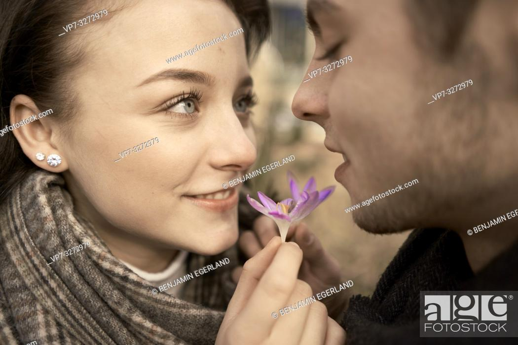 Stock Photo: young enamoured teenage couple with purple flower of spring outdoors in nature, love, in Cottbus, Brandenburg, Germany.