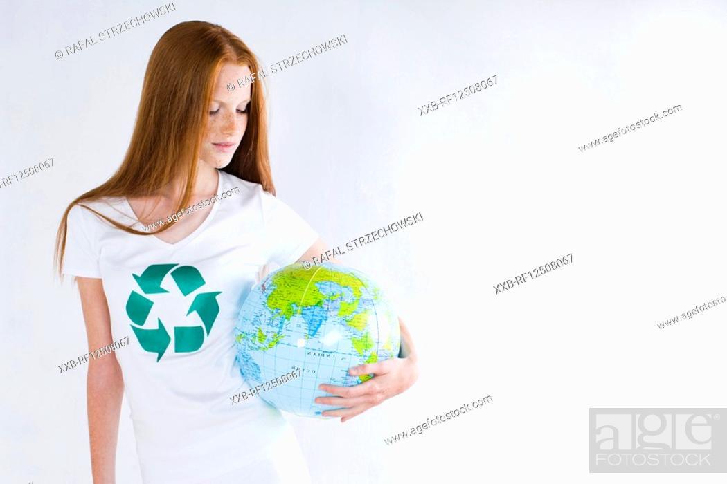 Stock Photo: woman holding globe.