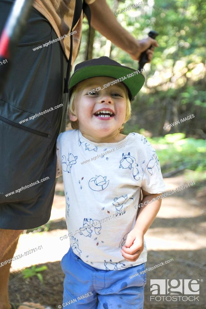 Stock Photo: Portrait of happy young boy hiking with his dad.