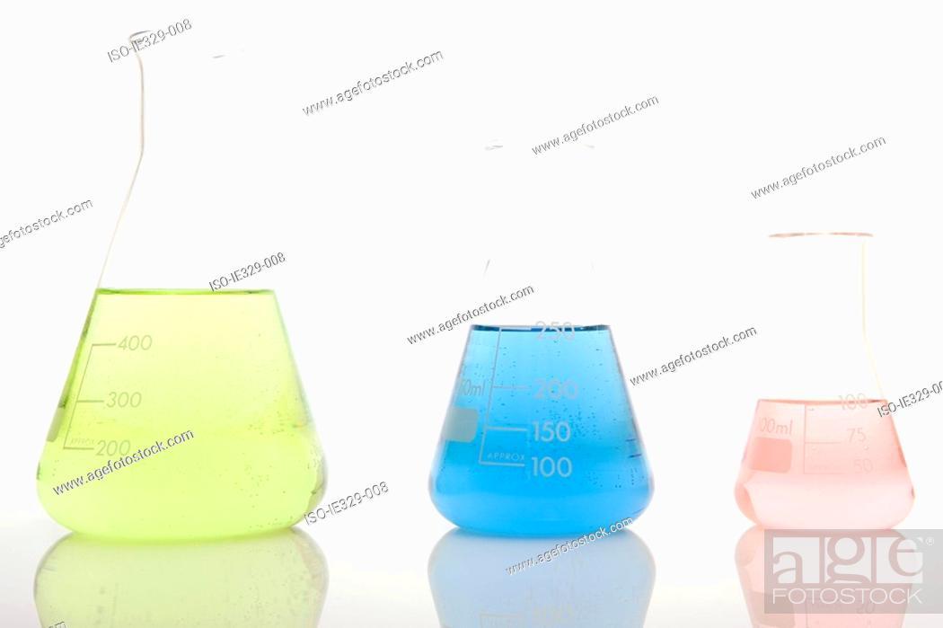 Stock Photo: Three volumetric flasks in a row.
