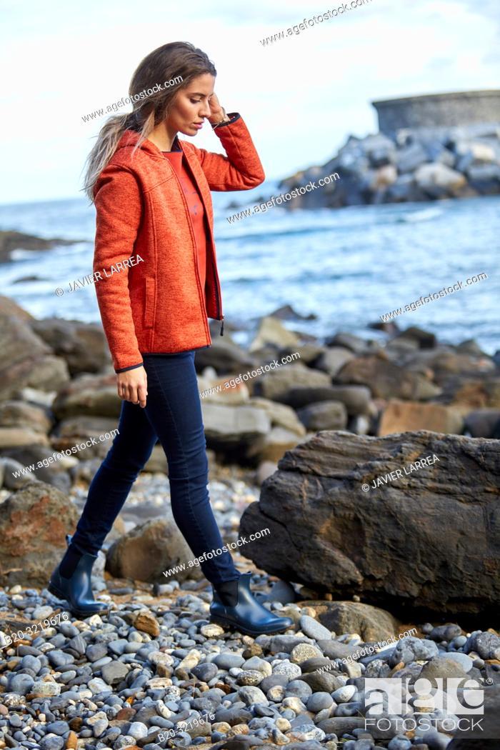 Stock Photo: Young woman, Beach, Mutriku, Gipuzkoa, Basque Country, Spain.