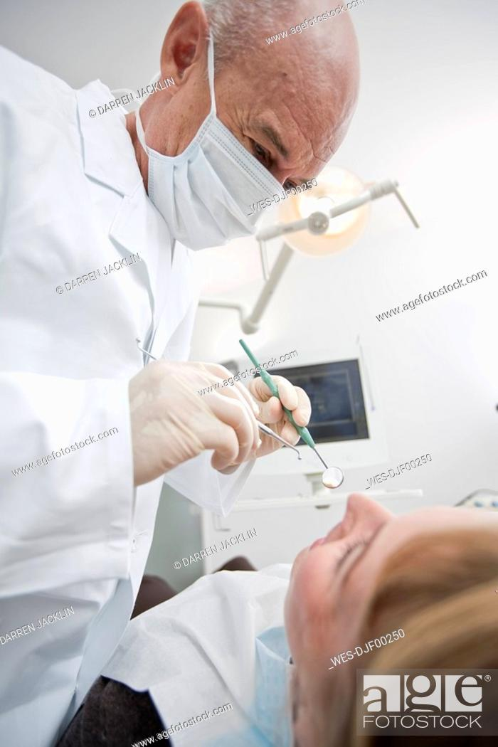 Stock Photo: Germany, Bavaria, Landsberg, Girl 8-9 having dental treatment.