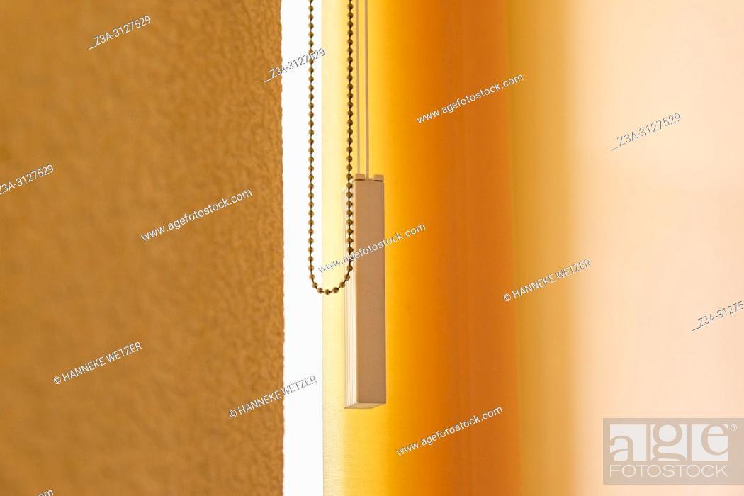 Photo de stock: Orange vertical window blinds.