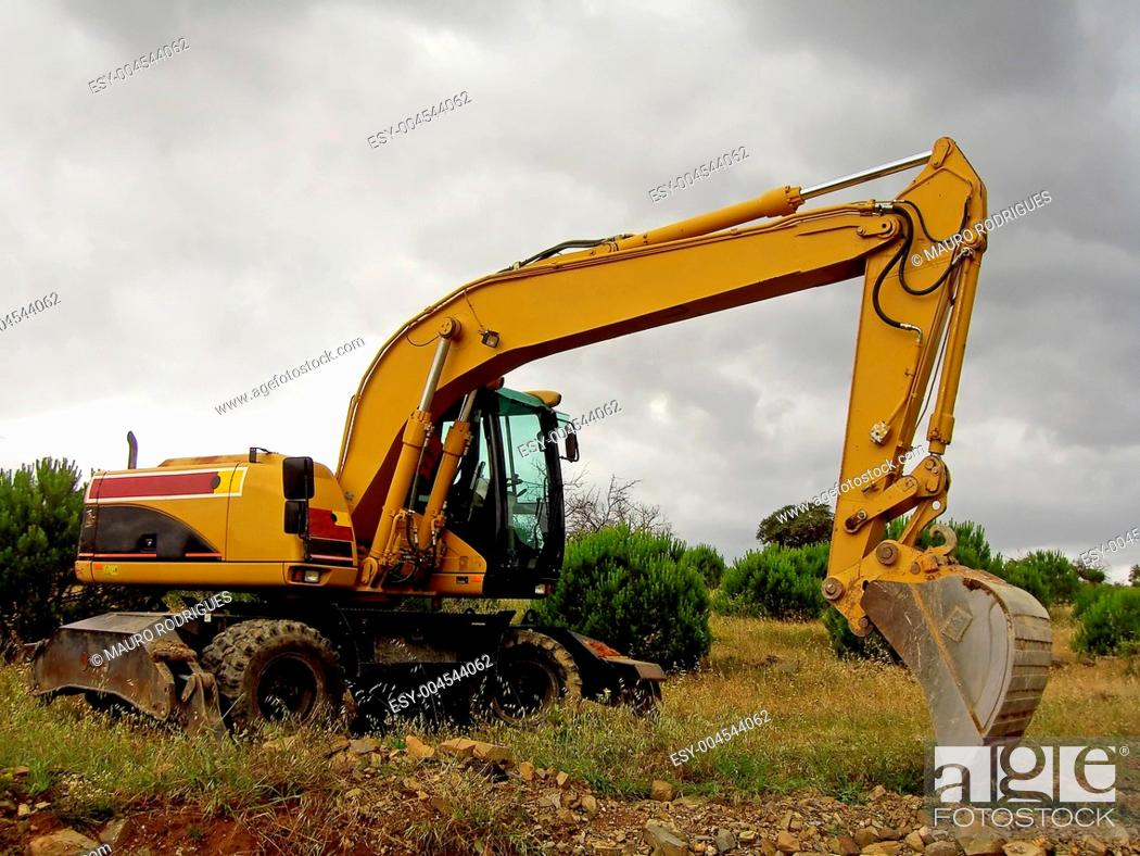 Stock Photo: Excavator on the field.