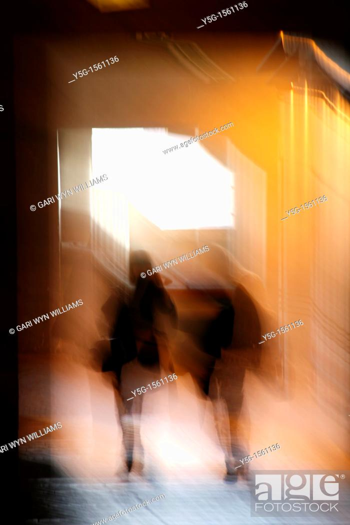 Stock Photo: abstract two people walking in dark corridor at night.
