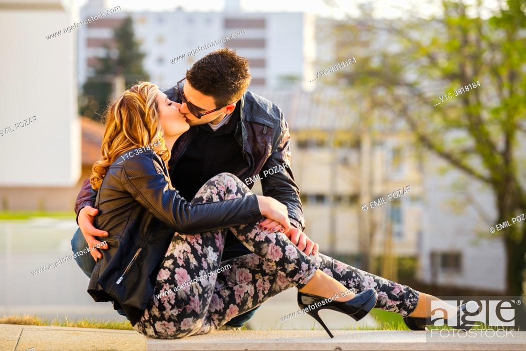 Stock Photo: Young couple sunset kiss.