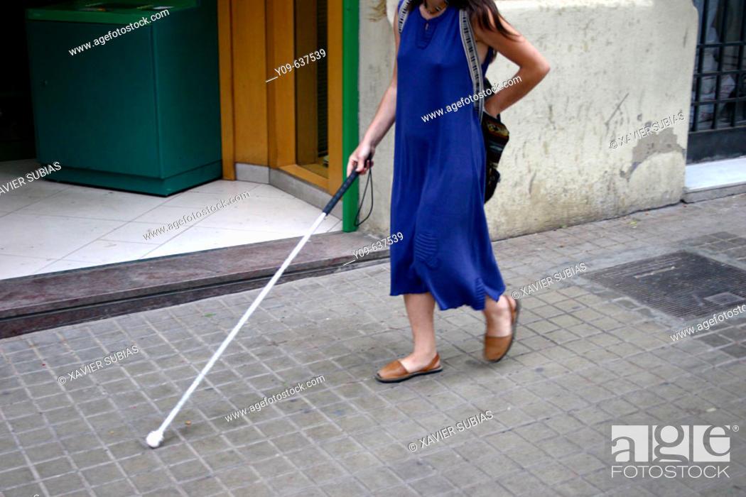 Stock Photo: Blind woman using walking stick.