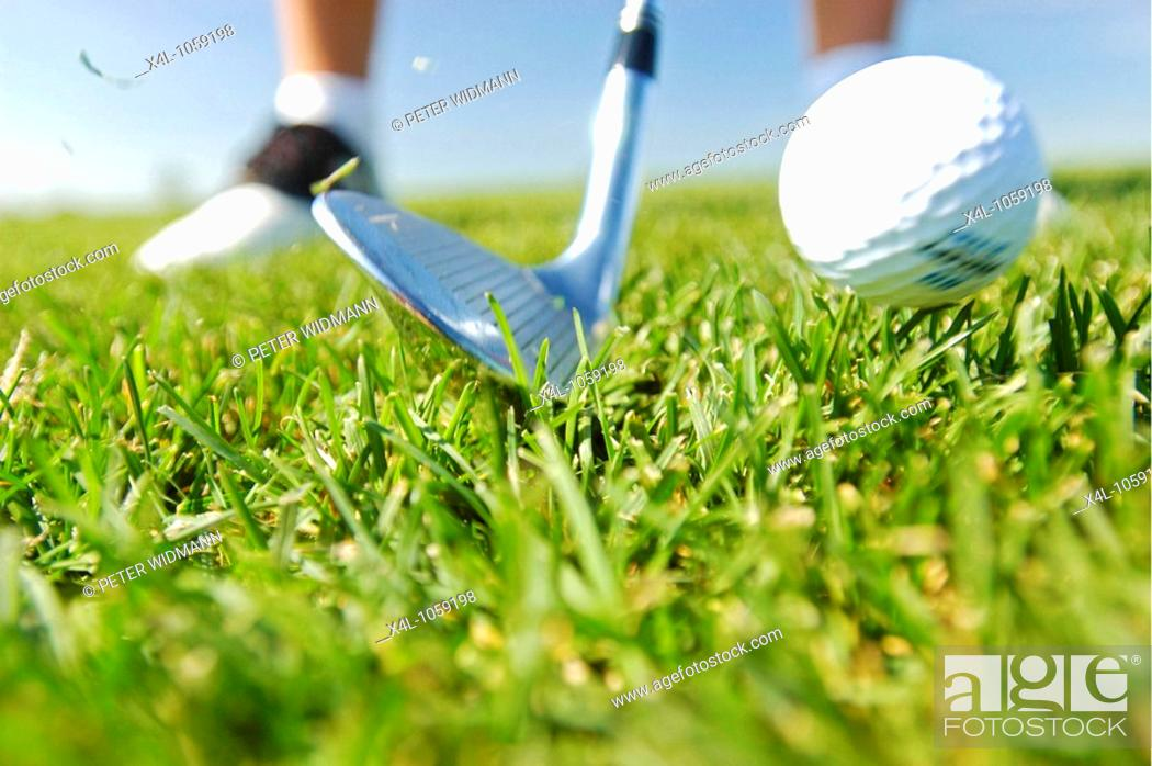 Stock Photo: man playing golf.
