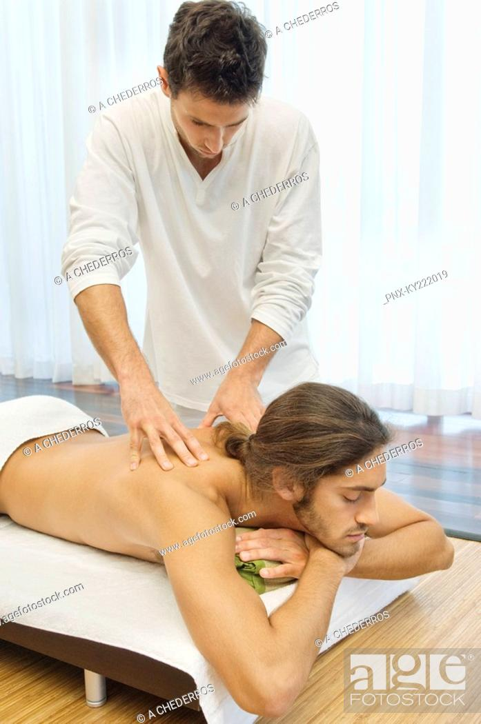 Stock Photo: Man receiving a back massage from a massage therapist.
