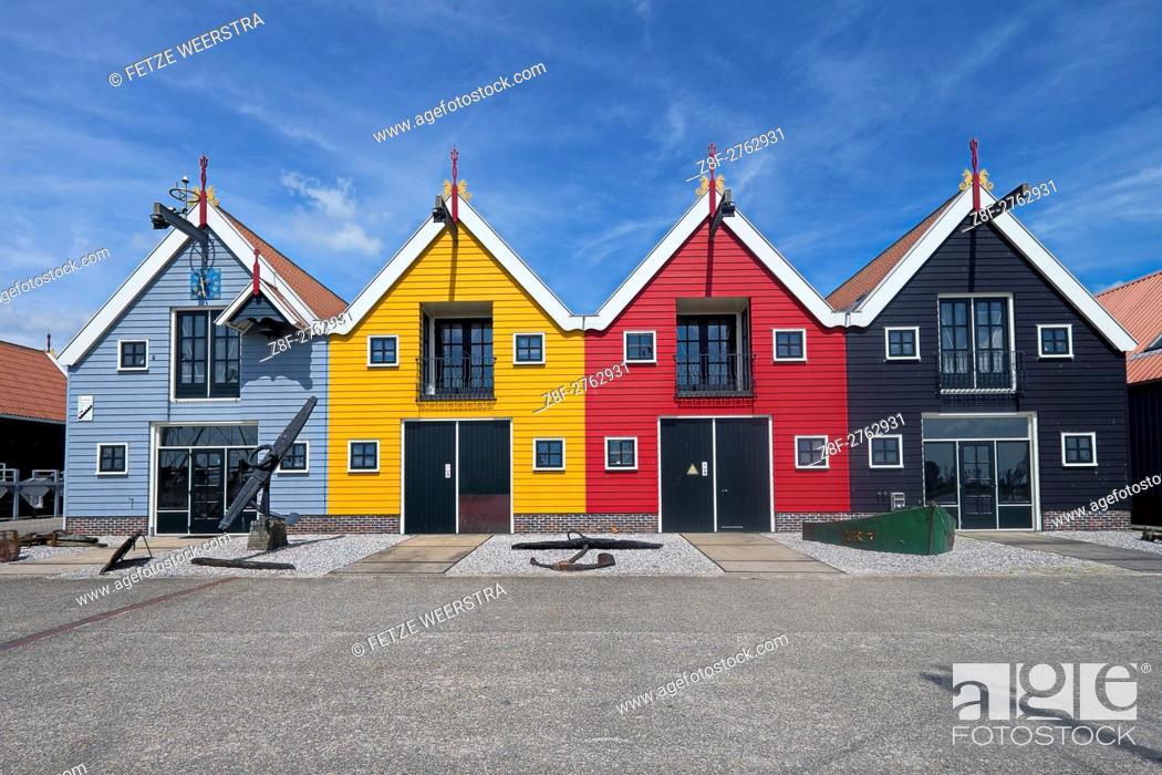 Stock Photo: Coloured houses in Zoutkamp (Groningen), the Netherlands.