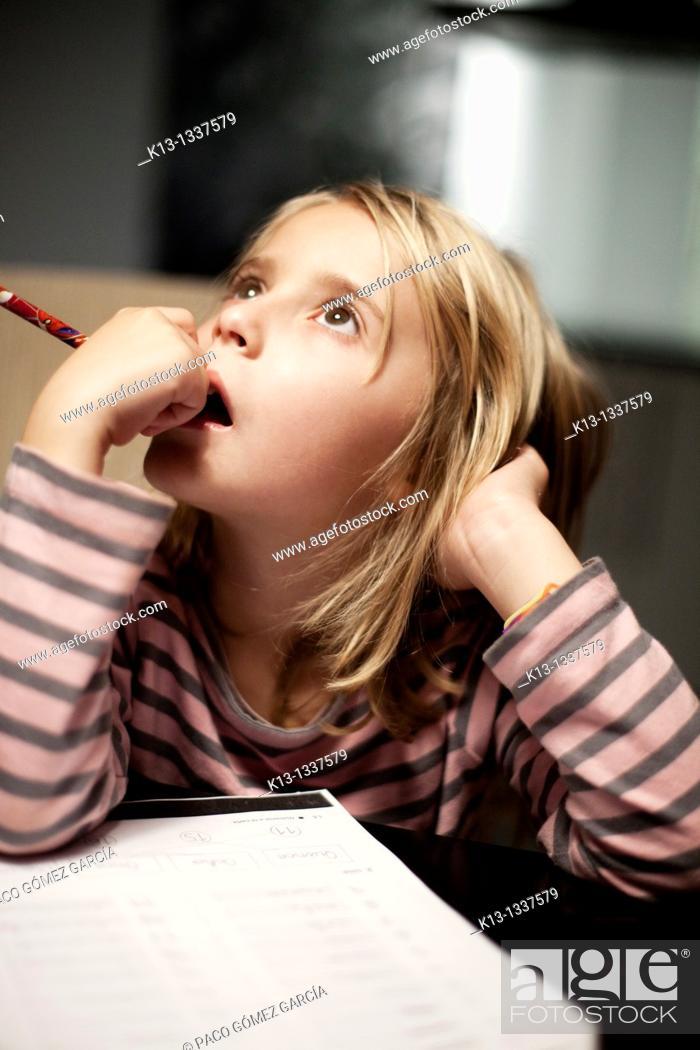 Stock Photo: Girl doing schoolwork.