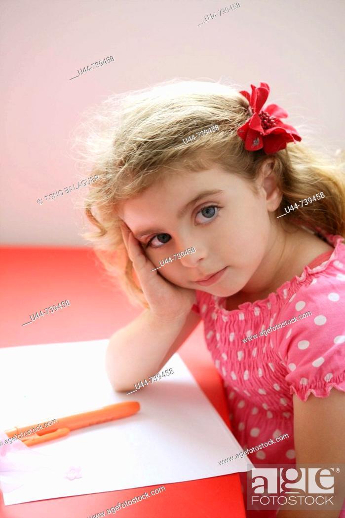 Stock Photo: Sweet girl stops doing her homework.