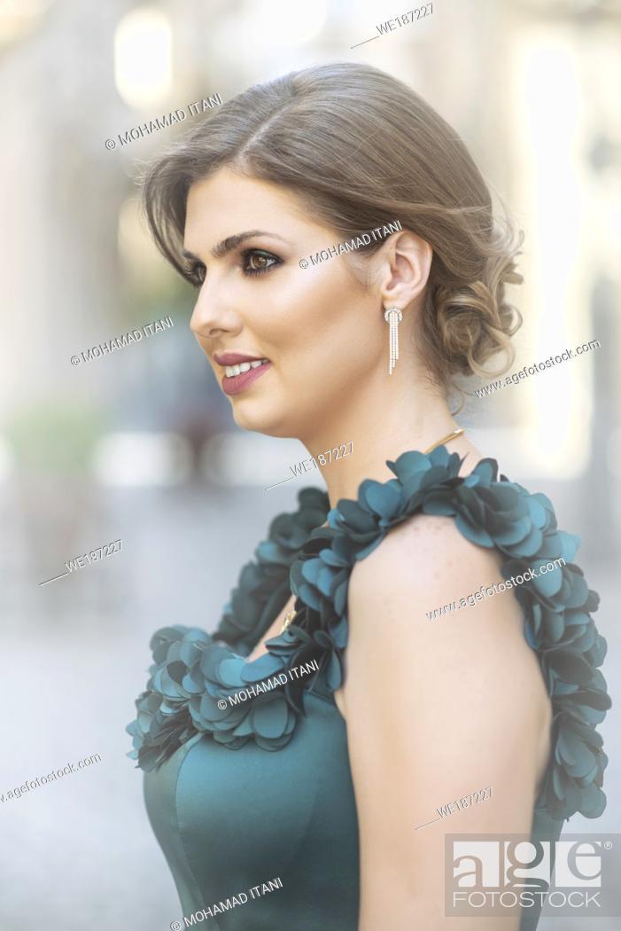 Stock Photo: Beautiful woman looking away smiling outdoors.