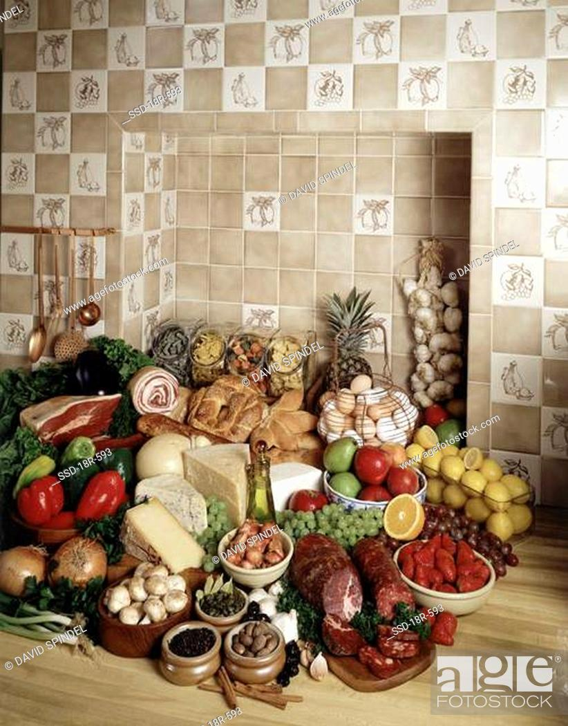Stock Photo: Assorted vegetables and fruits next to cheese and meats.