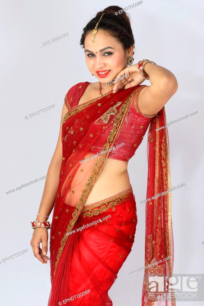 Stock Photo: Young Indian girl in red traditional sari.