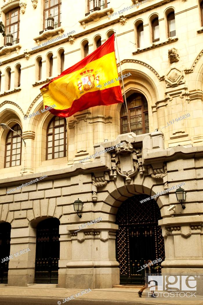 Stock Photo: Large spanish flaf outside Museo Naval, Madrid.