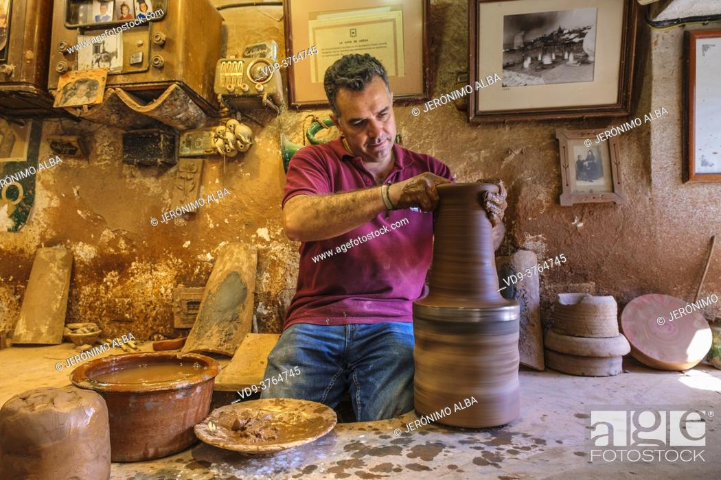 Stock Photo: The artisan Pablo Tito in his traditional ceramic workshop. Alfareria Pablo & Paco Tito, Ubeda. Cordoba province, Andalusia, Southern Spain Europe.