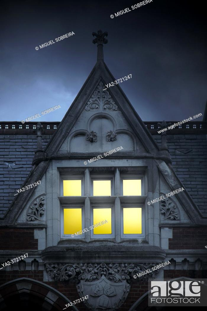 Stock Photo: Gothic Attic Window Lit Up.