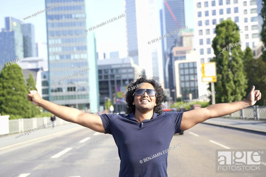 Stock Photo: Indian man on the middle of the street with arms open. Frankfurt, Germany.
