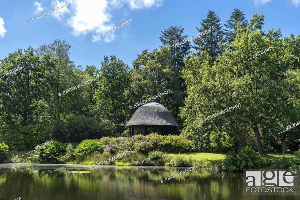 Imagen: Lake with pavilion in landscape garden and castle park of Lütetsburg Castle, Lütetsburg, Lower Saxony, Germany, Europe.