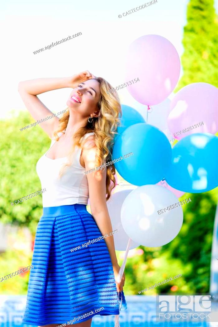 Stock Photo: Happy young woman with colorful balloons, Outdoors portrait.