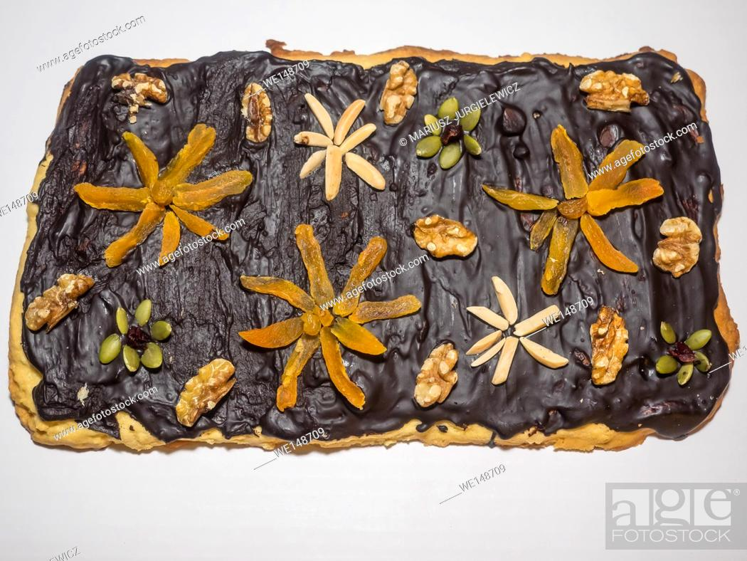 Stock Photo: Traditional Polish cake make for Easter with variety of toppings. Mazurek is usually colourfully iced and decorated with jam, nuts and raisins.