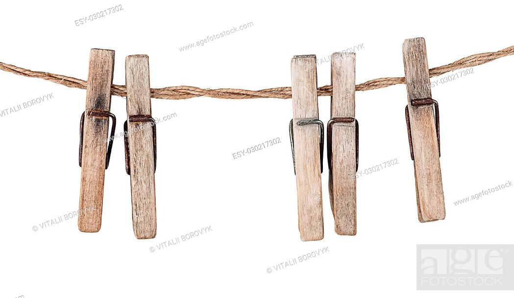 Stock Photo: Five old clothespins on rope isolated on white background.