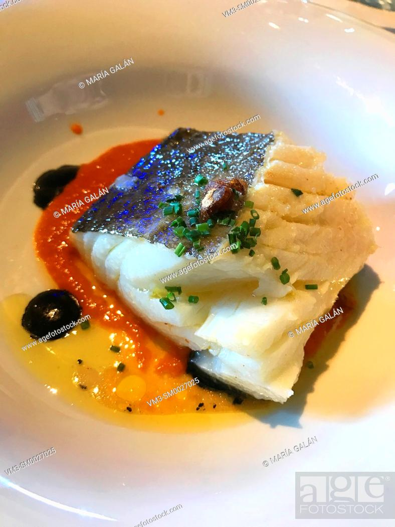 Stock Photo: Grilled sea bass loin with tomato sauce, olive oil and chives. Spain.