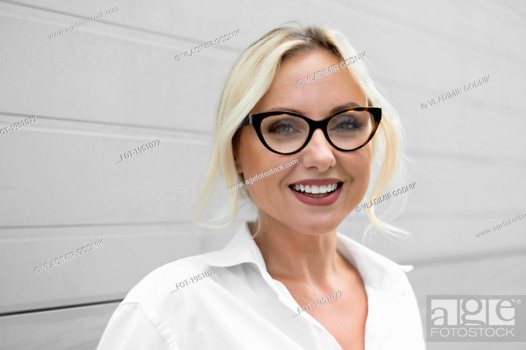 Stock Photo: Portrait happy, beautiful businesswoman in eyeglasses.